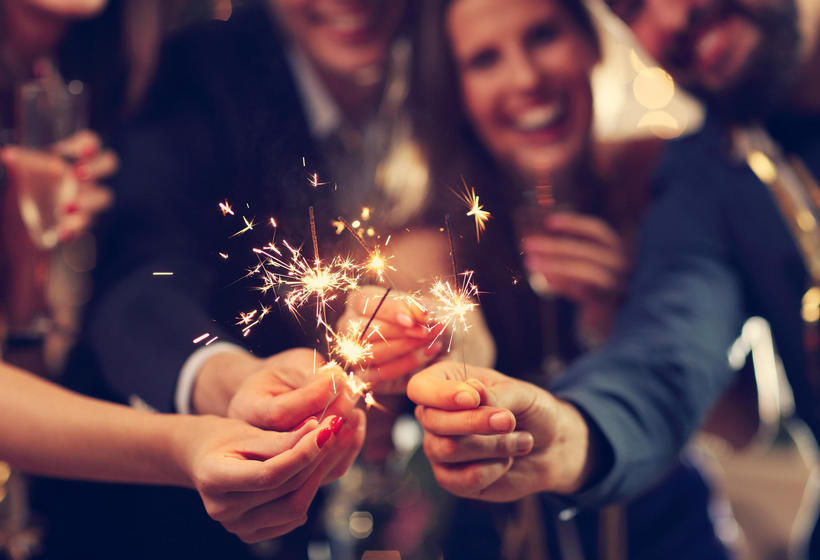 People holding sparklers in celebration