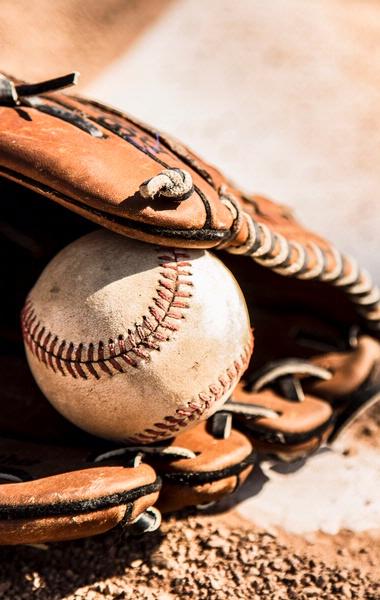 Baseball glove and ball on home plate